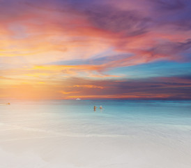 White sand and beach at sunset time with traveler enjoy swimming