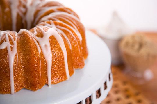 Close up of delicious bundt cake dessert sugar frosting homemade brown sugar ingredients