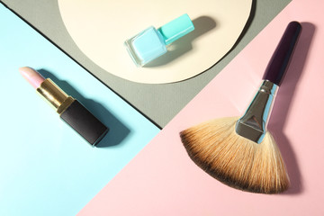 female cosmetics on a colorful background