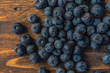 Fresh blueberry pile on wooden background