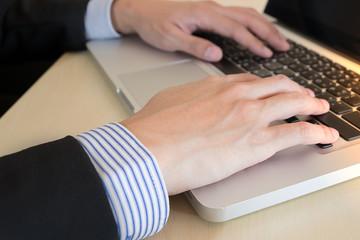 businessman hand typing