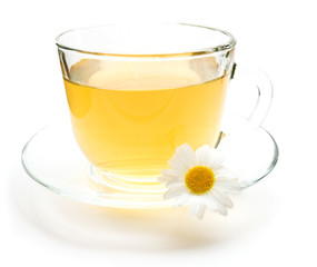 Cup of green tea with chamomile flower