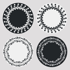 Set of silhouette round frames with floral elements. Design element for  logo, banners, labels, prints, posters, web, presentation, invitations, weddings, greeting cards, albums. Vector clip art.