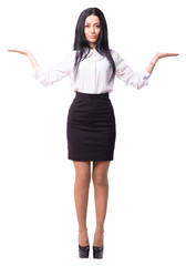 Cheerful young business lady makes a scales gesture. She offers you to make a choice. White background isolated. Full length cutout portrait.