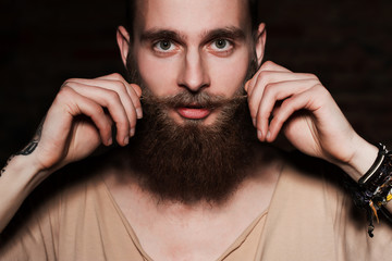young handsome bearded hipster man in studio