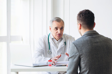 Senior doctor consults young patient