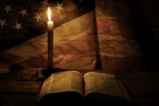 Old american flag and candle. Burning candle near a book. Wisdom comes with time. Learn the right things.
