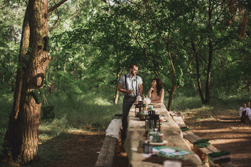 Man and woman have dinner in the park. banquet  outdoor