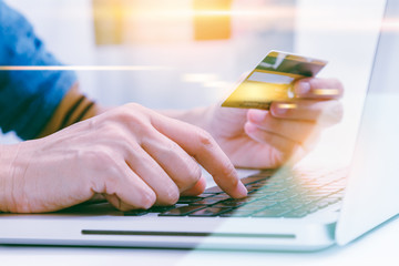 The online shoping card and holding credit card with hand for pa