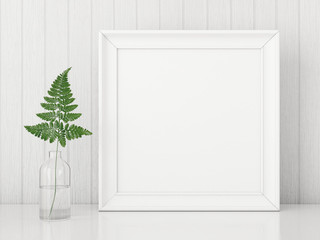 Square interior poster mock up with empty frame and fern leaf in glass bottle on white wall background. 3D rendering.