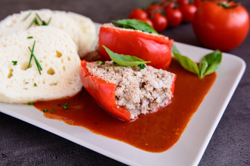 Red pepper stuffed with rice, minced meat and vegetable in tomato sauce with steamed dumpling