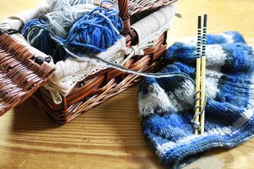 wool and knitting needles basket