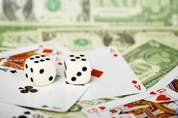 Dices are on cards and money