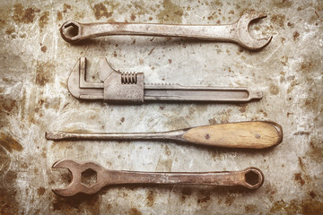 Old work tools on a metal background