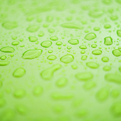 Green surface with drops of water