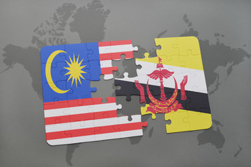 puzzle with the national flag of malaysia and brunei on a world map background.