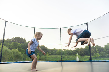 Children are jumping on trampoline