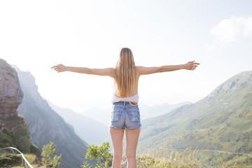 Young girl posing and enjoying with a beautiful horizon.