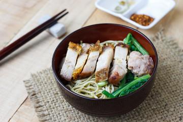 Egg noodles with vegetables and crispy pork ,selection focus
