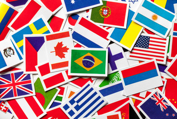 National flags of the different countries of the world in a scattered heap. Brazilian flag in the center.