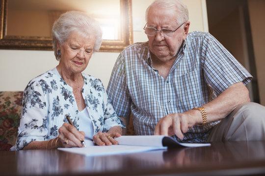 Senior couple doing retirement paperwork
