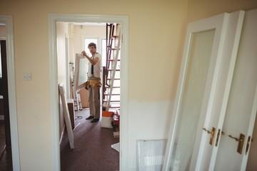 Carpenter working on a wooden door