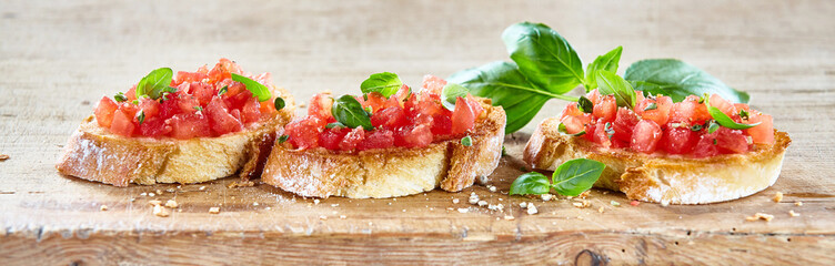 Delicious tomato bruschetta slices on a board