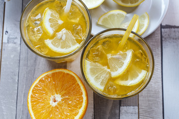 The cooled drink with fresh lemon and orange