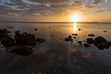 Golden sunset over  ocean coast.