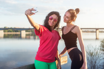 Women taking picture of herself, selfie at beach Lifestyle sunny image best friend girls happy vacations.