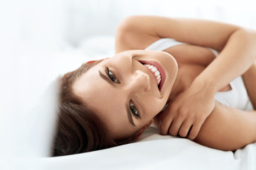 Woman's Health. Smiling Woman With Beautiful Face Skin. Beauty