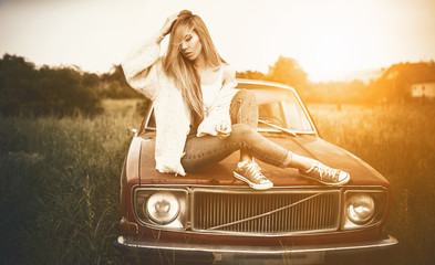 Vintage style of fashion women with old car / Lifestyle