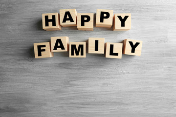 Words HAPPY FAMILY on light background
