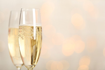Two champagne glasses on light background