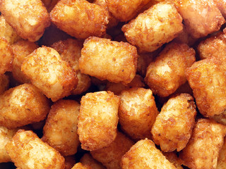 rustic golden potato tater tots food background