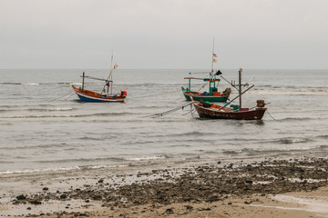 old tone sailing boat in the sea for catching fish of fisherman