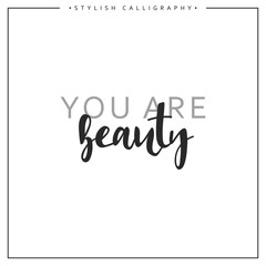 Calligraphy isolated on white background inscription phrase, you are beauty.