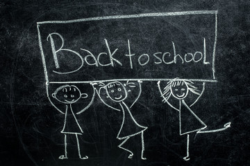 inscription in chalk on a black chalkboard back to school for students