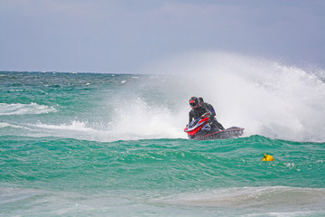 Young Man on Jet Ski. Professional jet ski rider. Jet Ski Champi