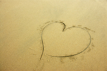 Heart on beach sand