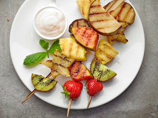 grilled fruits on wooden skewers