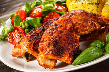 Roast chicken legs with boiled potatoes and vegetables