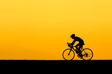 A Silhouette of man cycling