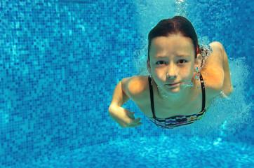 Children swim in pool underwater, making selfie, happy active girls have fun, kids sport on family vacation