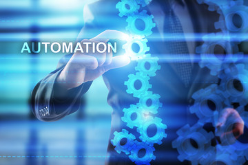 """Businessman is selecting """"Automation"""" on the virtual screen."""