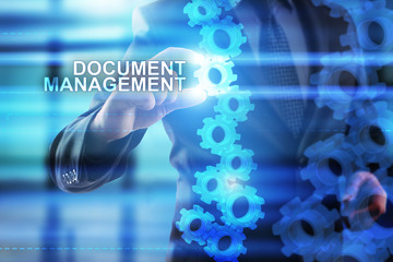 """Businessman is selecting """"Document management"""" on the virtual screen."""