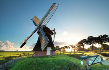 Wall Mural - old Dutch windmill at sunrise