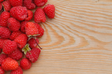 Raspberries on wooden background. Close up, top view, high resol