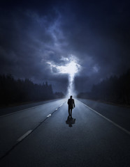 Man walking towards the storm