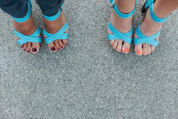 Woman's legs with a stylish sandals